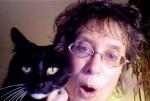 Melanie and her yoga cat, Dimi